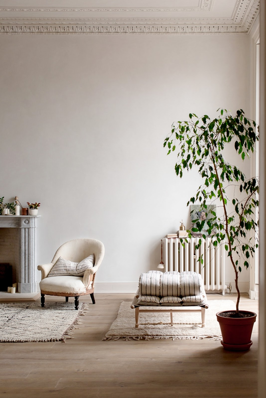 ilaria fatone - a comforting and minimal home - the living-room by the fireplace