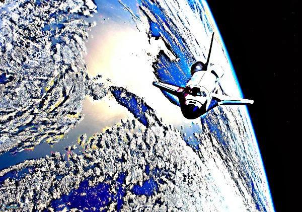 transbordador espacial orbitando el planeta