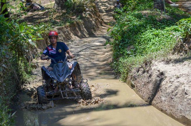 Riding an ATV at Puerto Galera