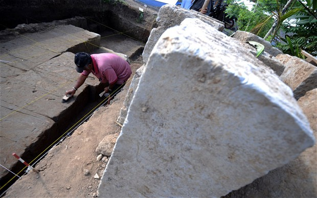 An archeologist excavates the remains of an ancient Hindu temple in Denspasar