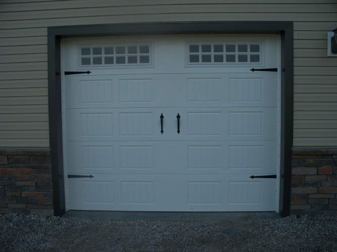 Carriage style garage doors cost myideasbedroomcom for Carriage style garage doors prices