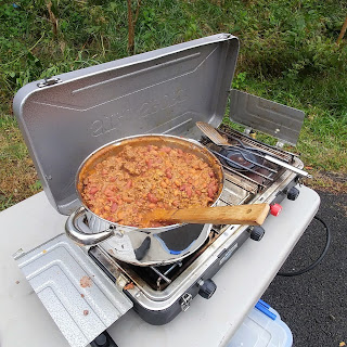 chili cooking on a camp stove