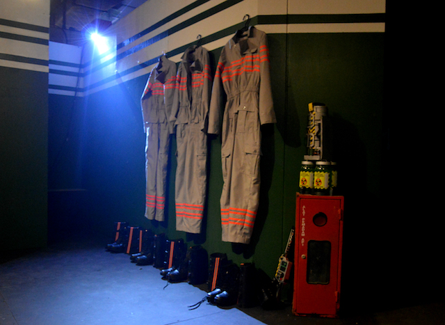 N. The Ghostbusters uniforms hang waiting to be used when they answer the call.