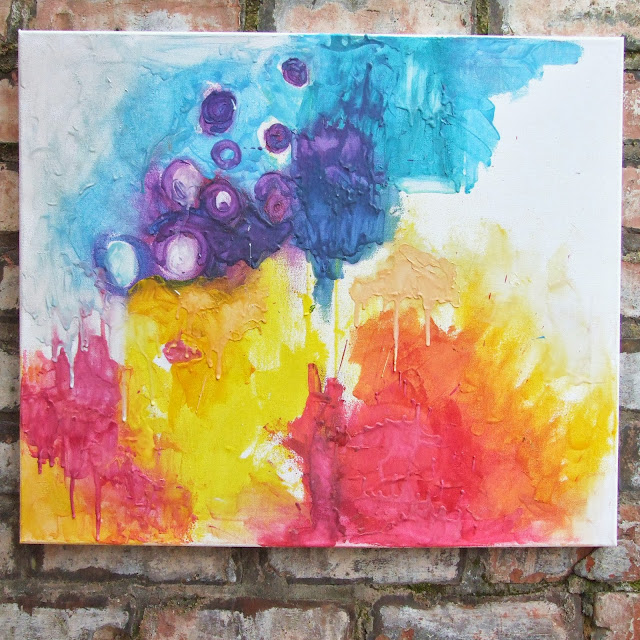Abstract art painted with melted crayons.
