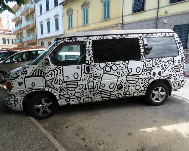 A curiously decorated van, Piazza della Vittoria, Livorno
