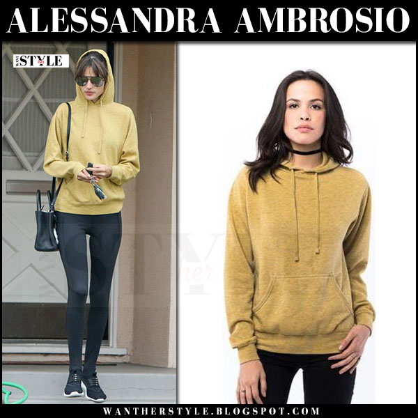 Alessandra Ambrosio in mustard hoodie, black leggings and black sneakers nike juvenate what she wore