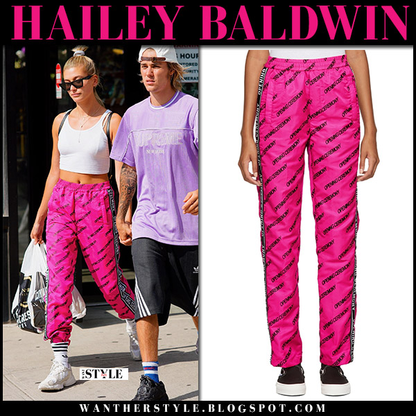 Hailey Baldwin in pink sweatpants opening ceremony and white top model street style july 26