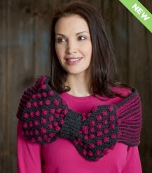 http://www.yarnspirations.com/pattern/crochet/ribbon-and-bow-cowl