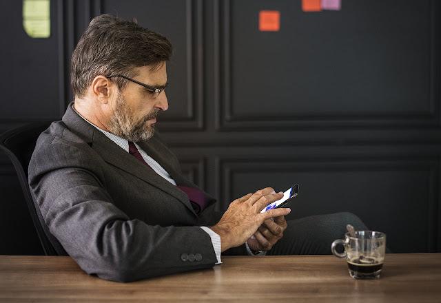 Businessman browsing his phone