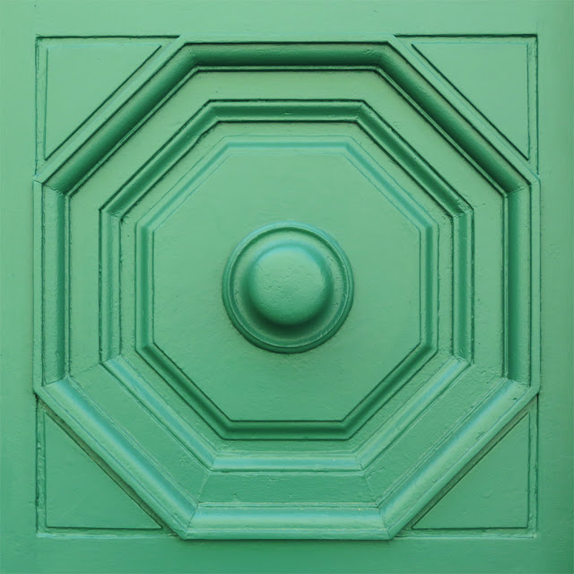 A detail of the green of the front door of the Cisternino, Piazza Guerrazzi, Livorno