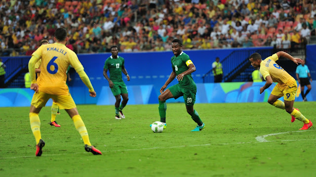 Mikel Obi controls the ball in midfield against Sweden
