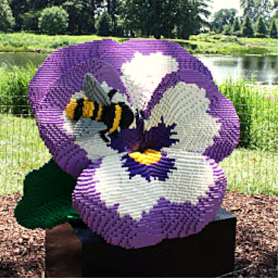 Bee enjoy a vibrant flower Lego sculpture by Sean Kenney at The Morton Arboretum