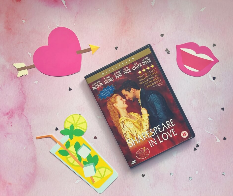 Shakespeare in Love DVD sits on a pink background surrounded by small silver hearts. In the bottom left corner is a picture of a glass of lemonade. In the top left is a pink heart with an arrow through it. In the top right corner is a smiling mouth with pink lips.