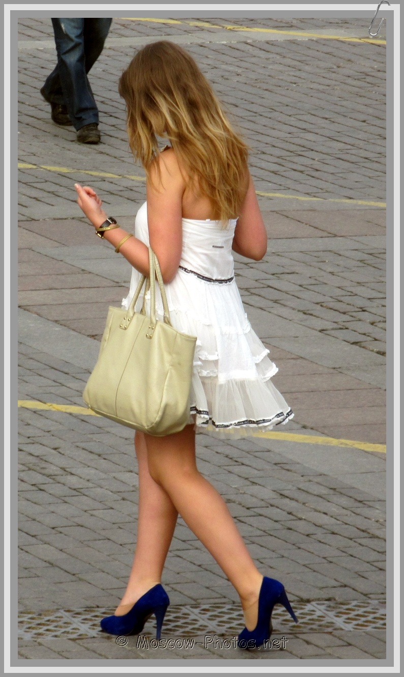 Girl In Summer White Mini-Dress On High Heels