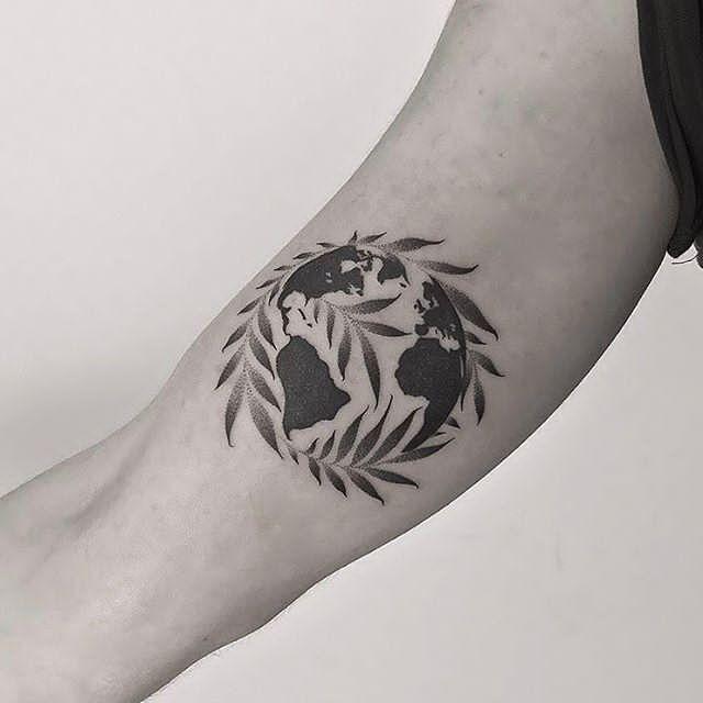 earth tattoo design for forearm