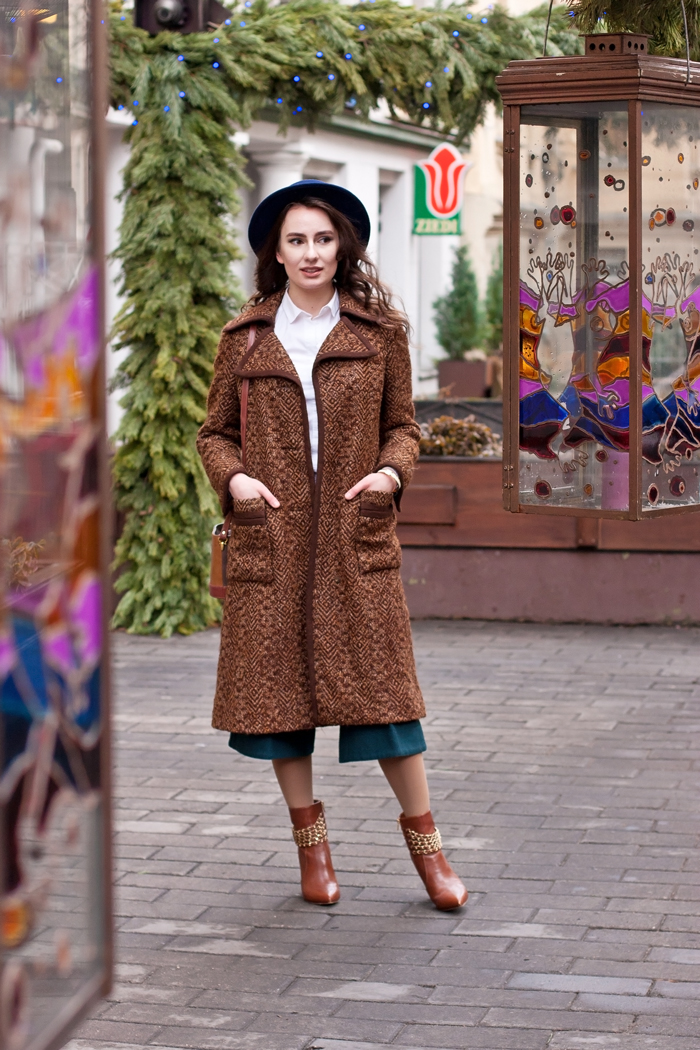 Lady in a Blue Hat and Brown Coat