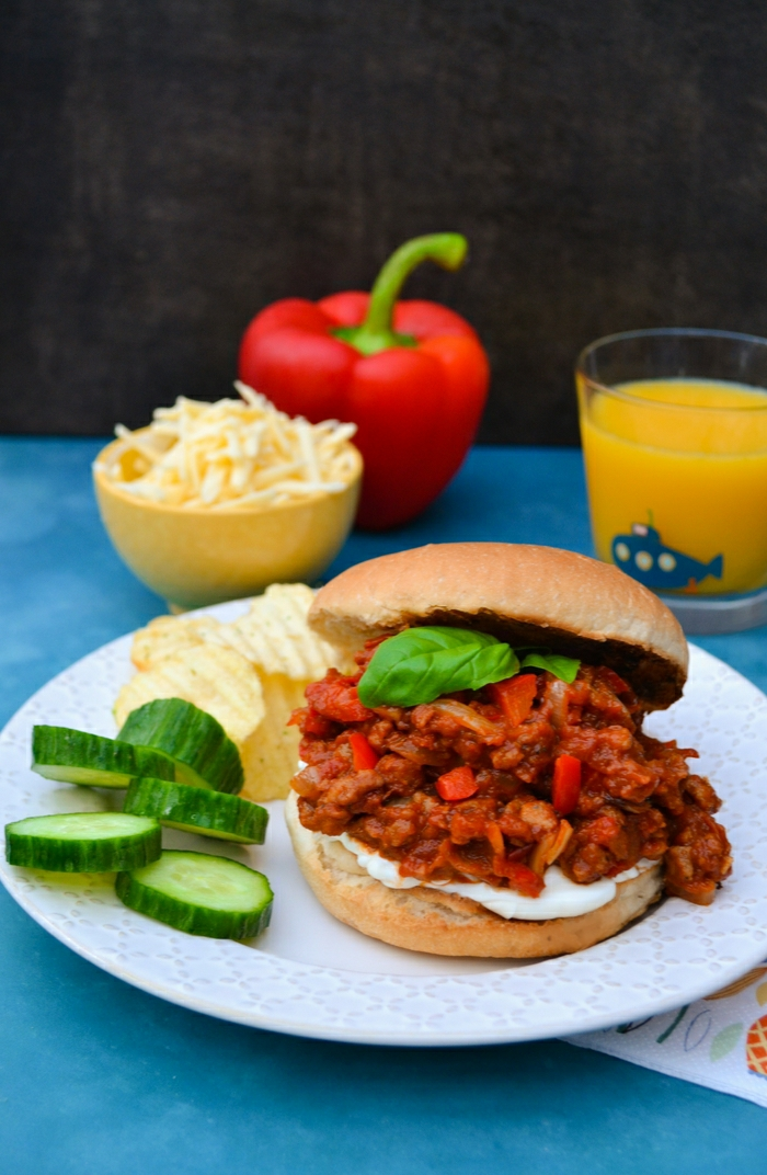 An easy recipe for vegan sloppy joes studded with red pepper and spiced up with paprika and cumin. Serve on a toasted bun with cream cheese and grated cheddar (vegan or veggie, it's up to you).