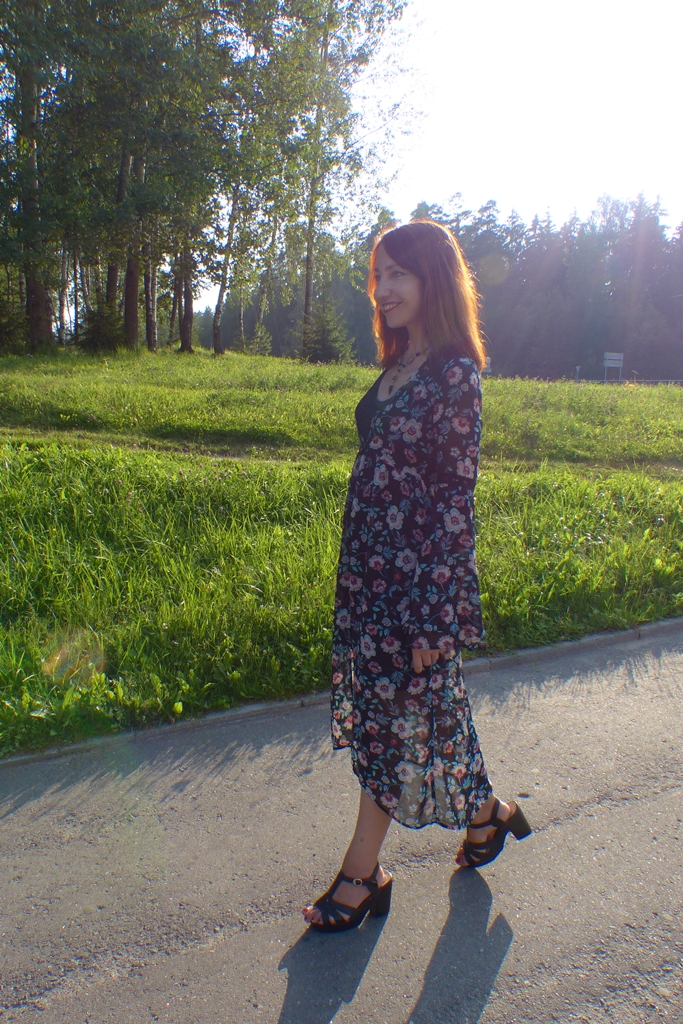 Floral overdress worn over black mini dress