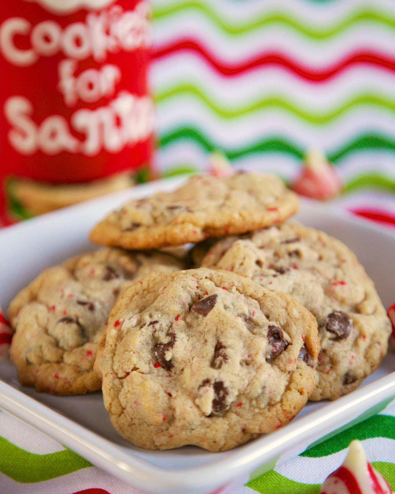 Candy Cane Kiss Chocolate Chip Cookies - chopped up candy cane kisses and chocolate chips combine to make a festive and delicious treat. Great addition to your holiday cookie tray! Everyone always asks for the recipe!!! A delicious holiday cookie recipe!