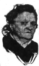 News clipping headshot of an elderly, scowling white woman with ussed dark hair