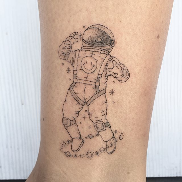happy astronaut tattoo