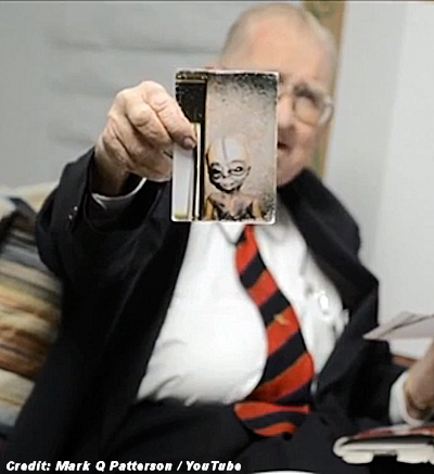 Bushman Holding His Alleged Photo of An Alien (2)