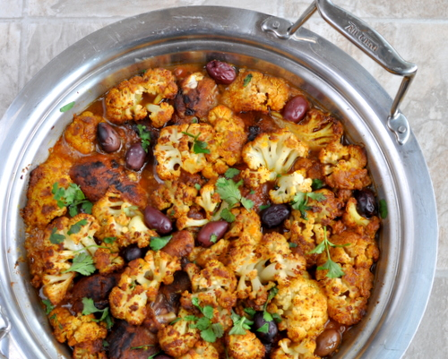 Spiced Chicken with Cauliflower Tagine ♥ KitchenParade.com, a one-pot supper, chicken and roasted cauliflower with warm spices and a touch of sour from Spiced Preserved Lemons. Low Carb. Gluten Free. High Protein. Weight Watchers Friendly.