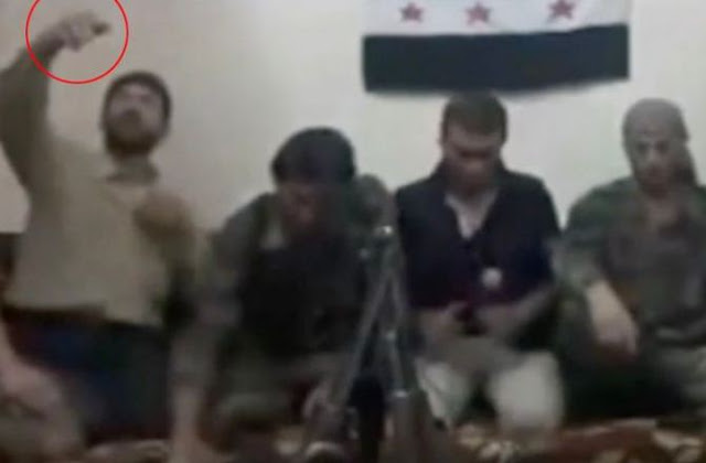 photos: Syrian rebel mistakenly blows self and comrades up while trying to take selfie with bomb wire phone.(iphotos)