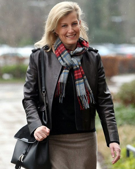 Countess Sophie wore Prada black leather jacket, ankle-skimming merino-wool skirt by Gabriela Hearst and a colourful tartan scarf.
