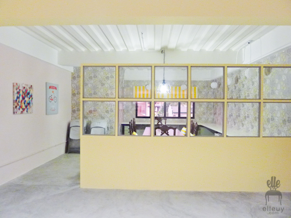 pink and yellow walls with concrete floors