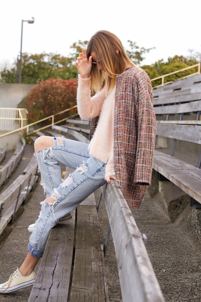 Vancouver Fashion Blogger, Alison Hutchinson, is wearing a pink mohair sweater from Minkpink, One Teaspoon Awesome Baggies, Converse sneakers, and a botkier bag