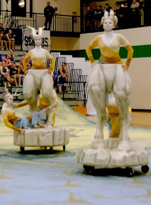 mythical beast carved floats, statues on wheels for dance team by Aaron Christensen