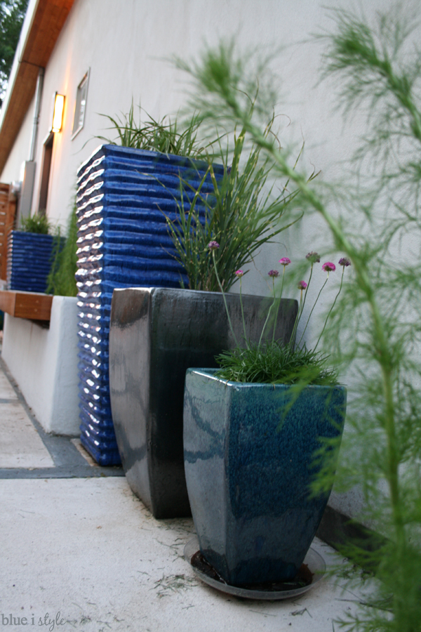 planter bench and blue pots