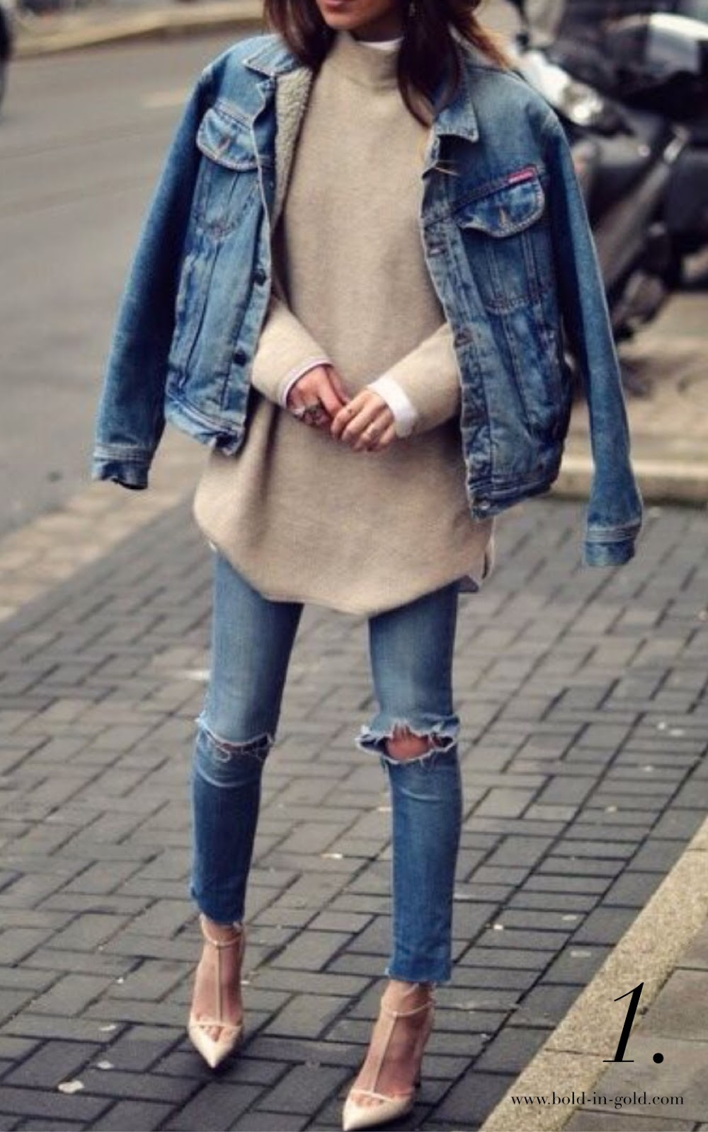 Woman wearing ripped jeans with brown sweater and nude heels