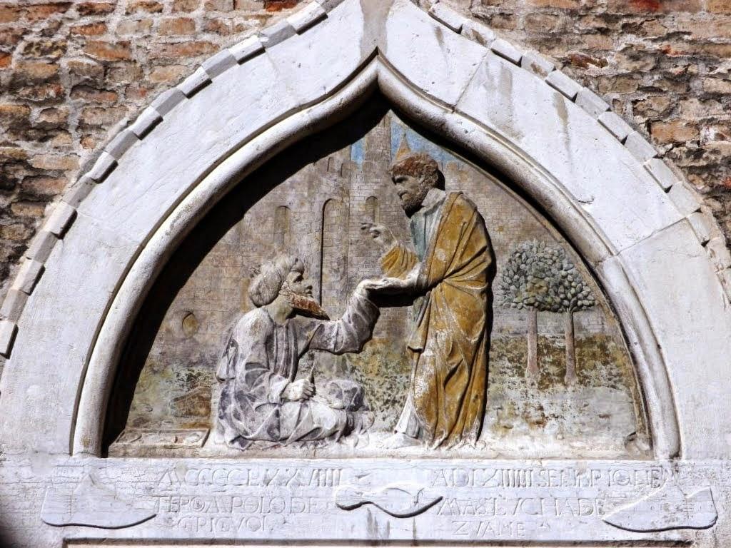 15th century bas-relief above the entrance to the Scuola dei Calegheri in Venice.
