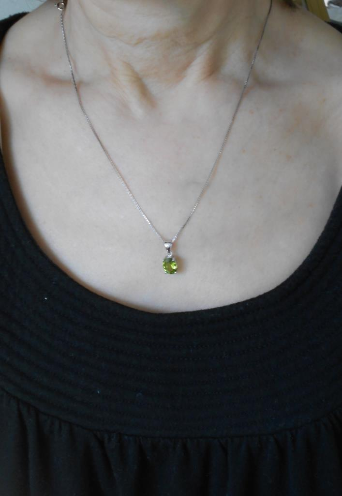 modeling Majesty Diamonds peridot necklace