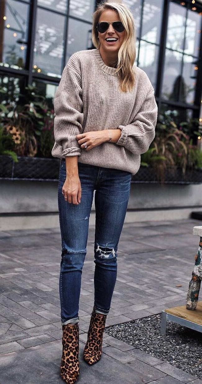 cozy fall outfit / nude oversized sweater + ripped jeans + leopard boots