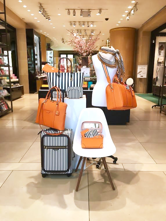 Luggage set in orange and classic brown and white stripe