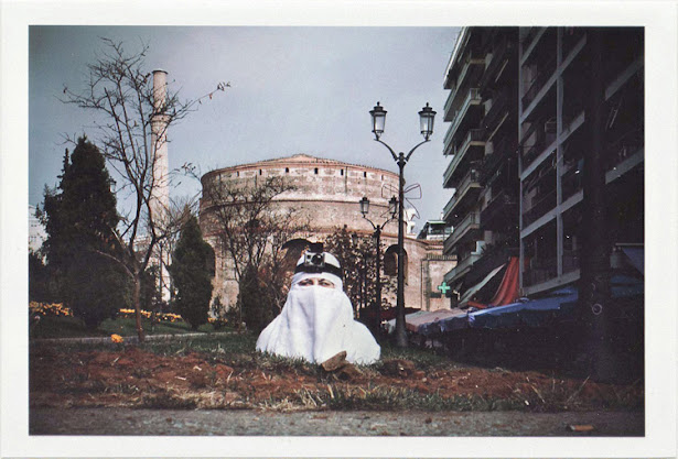 dirty photos - Once - street photo of arab girl in front of rotonda , thessaloniki