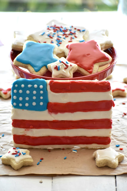 Gluten free red white and blue sugar cookies on a cake plate