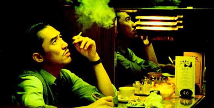 Mr. Chow (Tony Leung) smokes a cigarette in 2046.