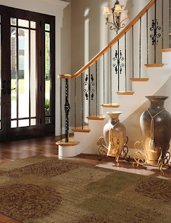 An area rug creates adds a welcoming and beautiful touch to this entryway.