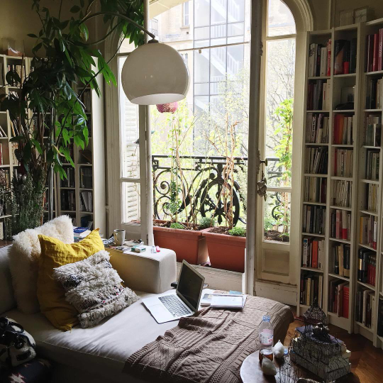 Books and an oversized plants and well layered bed make for a cozy bedroom-design addict mom