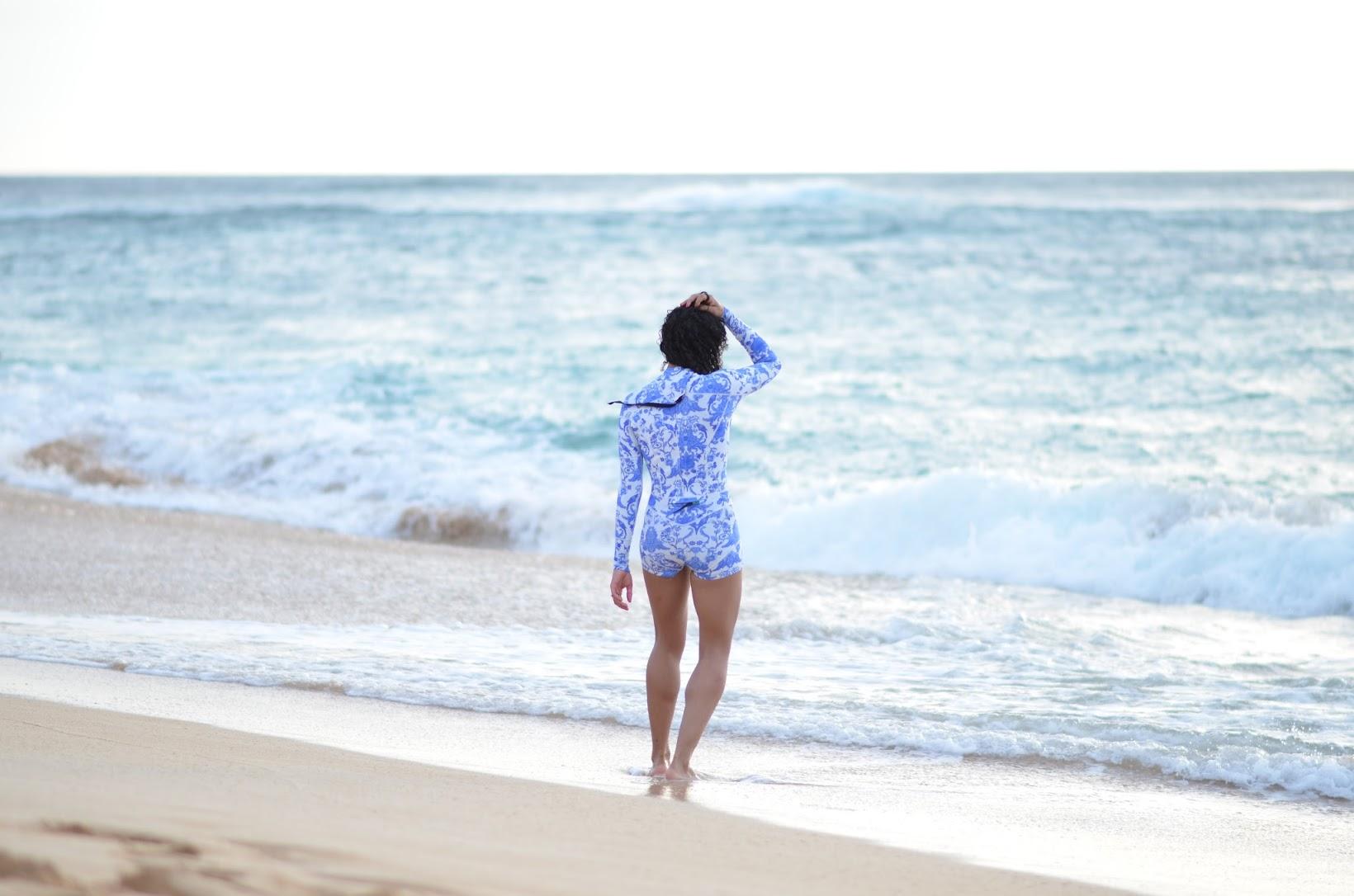 Cynthia Rowley wetsuit, blue ruffle crop top, sunset beach oahu, curly hair