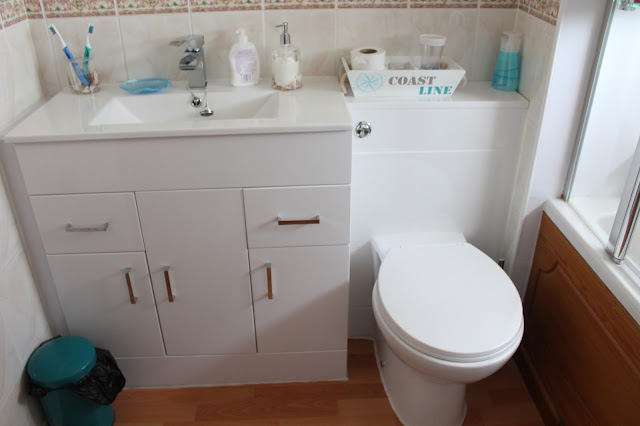 nautical bathroom with white cupboard sink unit