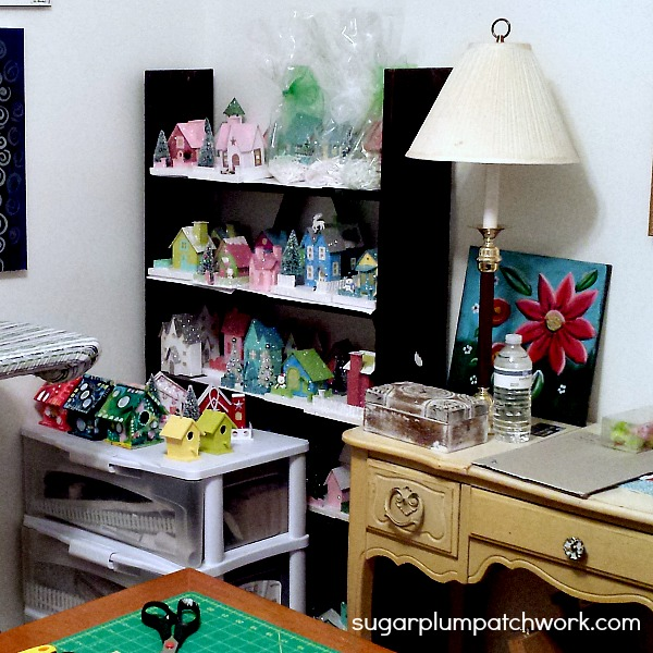 Glitter putz houses on shelves in craftroom
