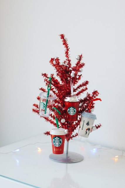 Fashion and Travel Blogger GlobalFashionGal (Brianna Degaston) decorates her Singapore apartment for Christmas with a Starbucks themed Christmas tree.
