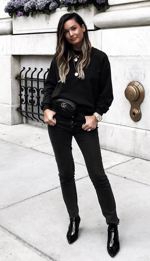 black outfit inspiration | sweatshirt + waist bag + skinny jeans + boots