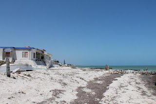 Chabihau beach with some properties to the left.