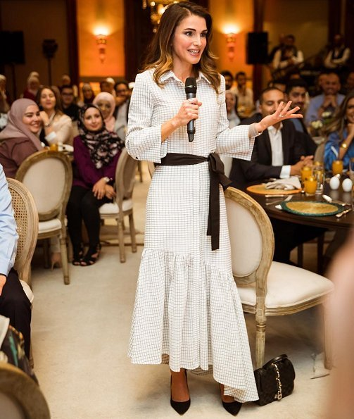 Queen Rania of Jordan held an Iftar banquet for Jordanian youth at Basman Palace wore asymmetric belted shirt dress, she carried Louis Vuitton bag